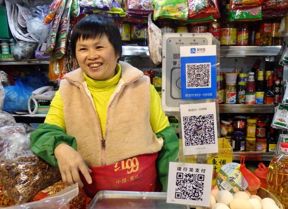 http://asia.nikkei.com/Business/AC/China-s-Tencent-grabs-830m-mobile-payment-users